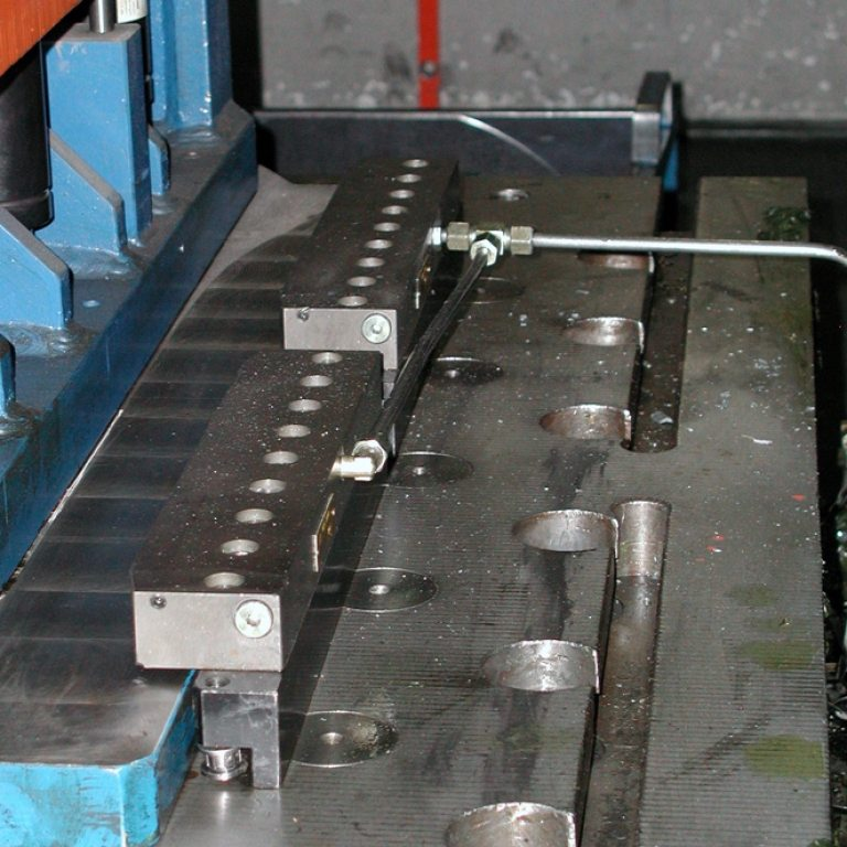 MLC ledge clamping bar